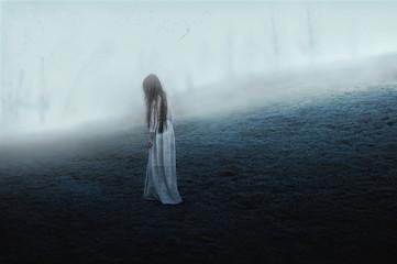 Woman walking on misty hill