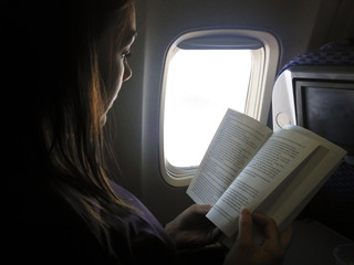 Woman reading on flight