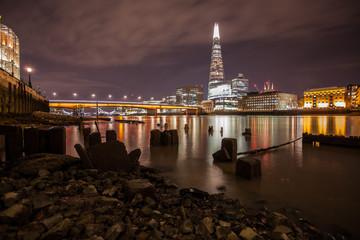 UK, England, London, Thames River, City buildings illuminated at night