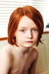 Portrait of redhead boy (6-7)