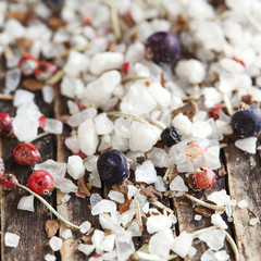 Salt crystals and berries on wood