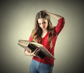 Girl reading an ancient book