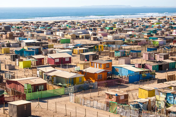 Chile, High angle view of multi colored huts on beach