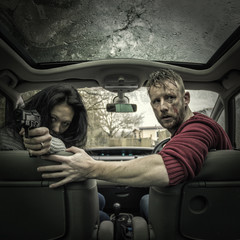Couple in car with gun