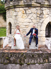 Young wedding couple in front of a castle