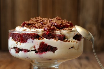 Rye bread tiramisu with cherries, chocolate and silver spoon on