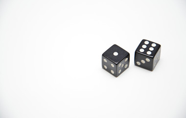 two black dice on a white background