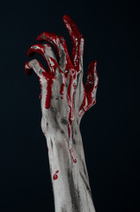 horrible zombie demon bloody hands on a black background