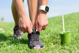 Running shoes sports smartwatch and green smoothie