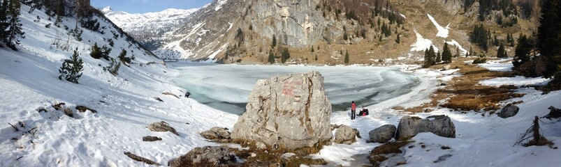 Mountain landscape with frozen lake in the winter