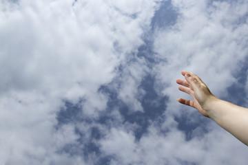 Hand reaching to heavens