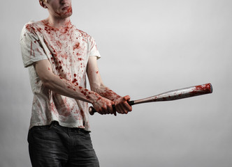 guy in a bloody shirt holding a bloody bat on a white background