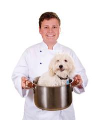 Junger Koch mit Hund im Kochtopf