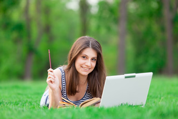 girl with laptop computer and book