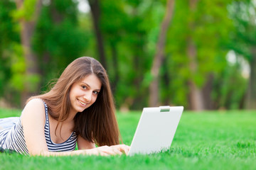 brunette student girl with laptop computer