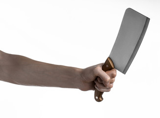 Hand holding a knife for meat, chef holding a kitchen knife