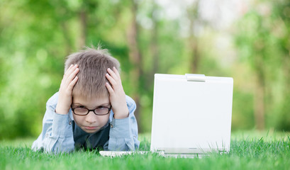 young sad boy with laptop computer