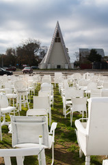 White chairs in front of 'Cardboard Cathedral, Christchurch