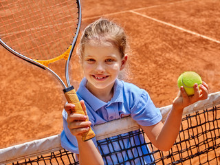 Girl athlete  with racket and ball on  tennis court