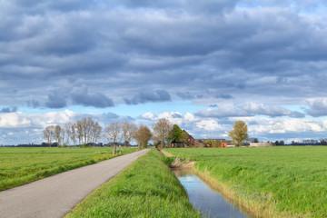 Dutch farmland with clouded sky