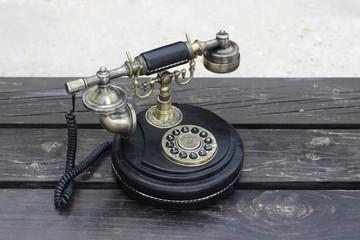 Vintage phone on planks