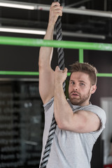 Man pulling-up on rope