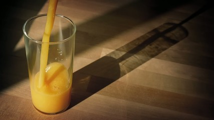 Orange Juice Poured Into Glass With Shadow