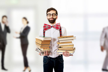 Man with suspenders holding books.