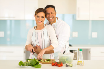 couple have fun in modern kitchen