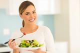 vegetarian eating salad at home