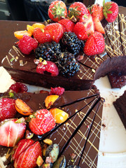 Fruits on chocolate cakes