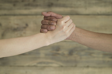 Men and women have formed a hand