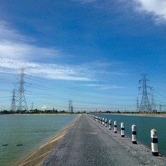 Road and reservoir of water for irrigation