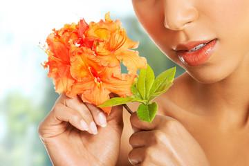 Beauty woman with orange flower.