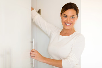 woman opening a closet door