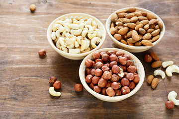three kinds of nuts in a bowl