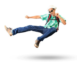 young man with back pack sky kick jumping action isolated white
