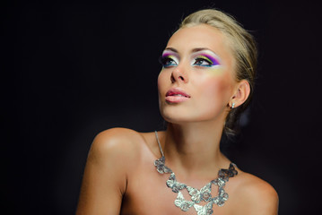 Girl model with professional makeup and hairstyle