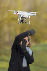 Flying drone with camera scares a woman