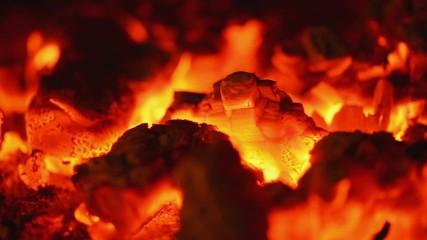 Firewood on fireplace - steadicam closeup
