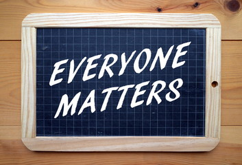 The phrase Everyone Matters in text on a blackboard