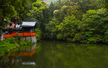 Shrine and pond scene in Kyoto, Japan.
