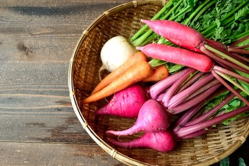 Colorful root vegetables on bamboo basket