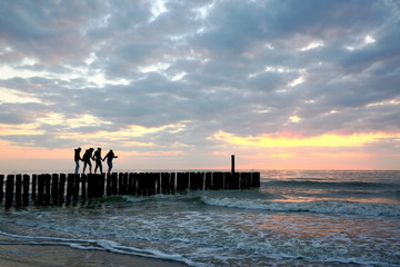 acrobatic sunset walk on groyne