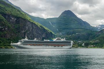 Cruise ship standing near Geiranger, Norway