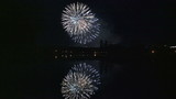 Fireworks reflected in the water of the lake