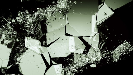 glass shattered and broken with slow motion on black