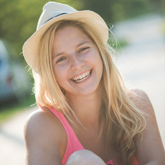 Summer girl portrait. Blonde woman smiling happy