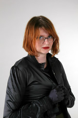 Redhaired woman in glassses in black gloves and blouse