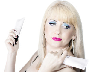 the beautiful blonde with cosmetics in hands